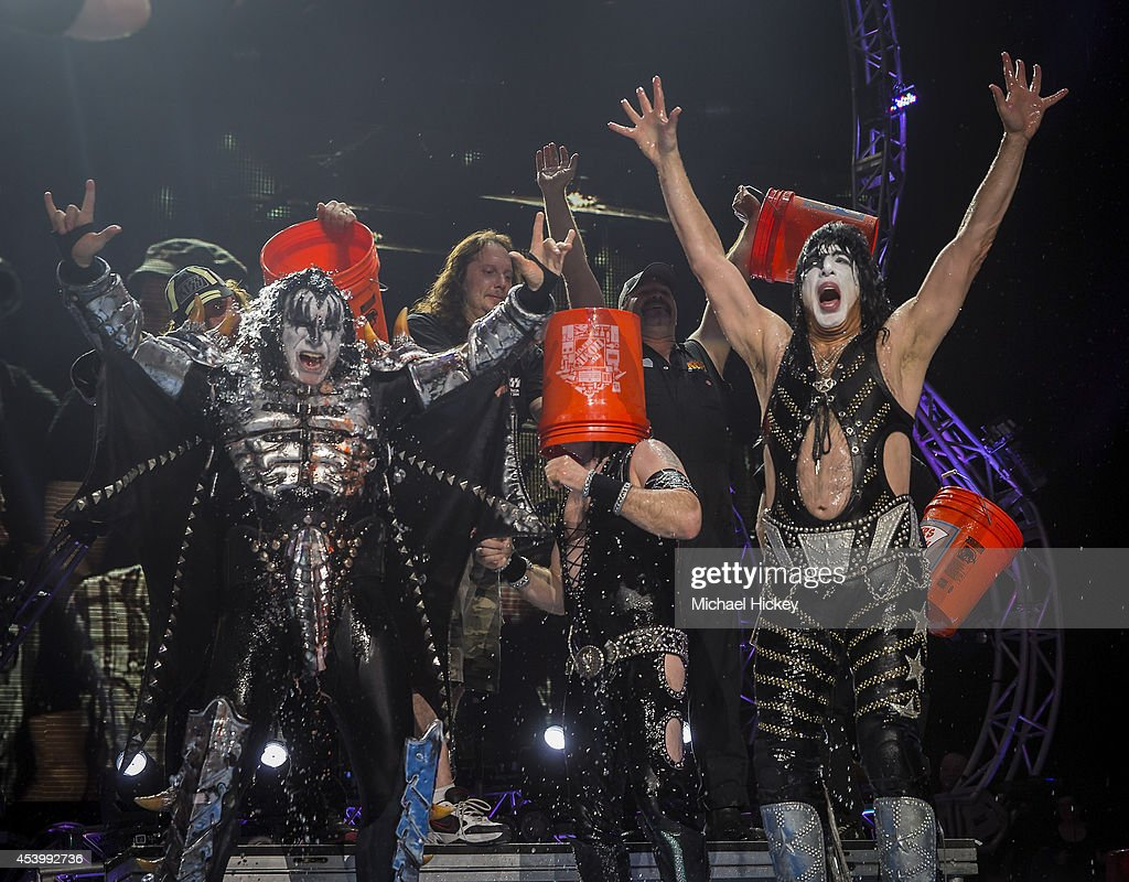 Gene Simmons Eric Singer and Paul Stanley of the band KISS participates in the ALS Ice Bucket Challenge at Klipsch Music Center on August 22 2014 in...
