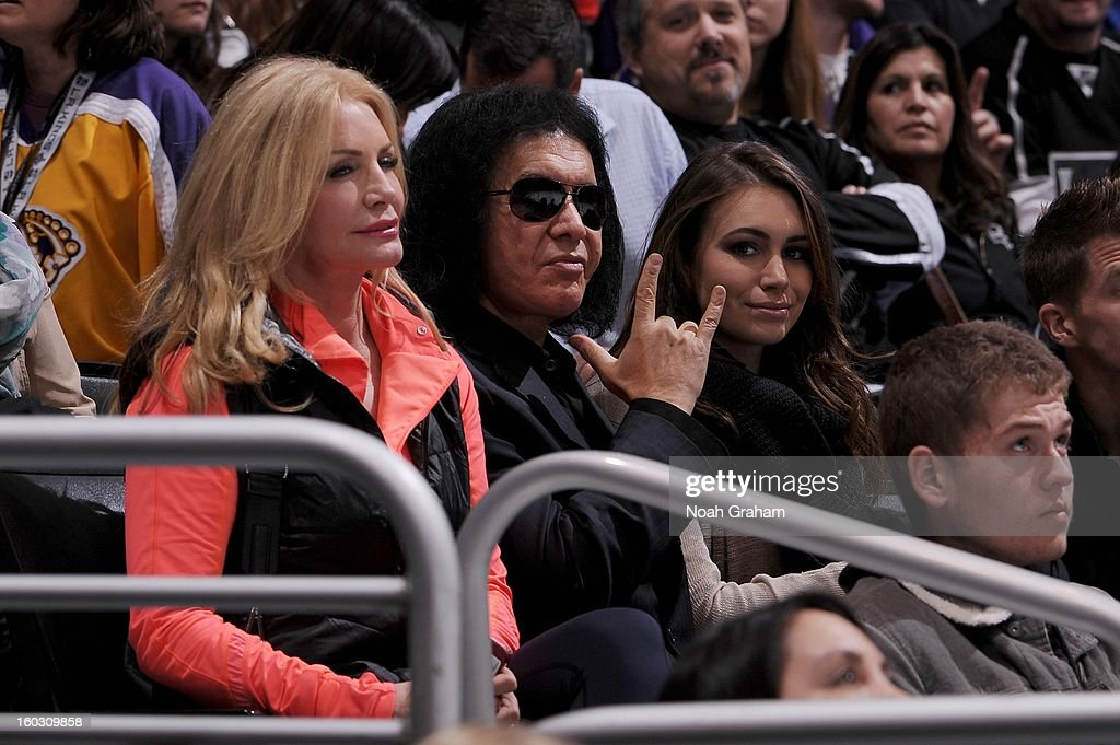 Gene Simmons, wife Shannon Tweed (L) and and daughter Sophie Simmons (R) watch the game between the Los Angeles Kings and the Vancouver Canucks at Staples Center on January 28, 2013 in Los Angeles, California.