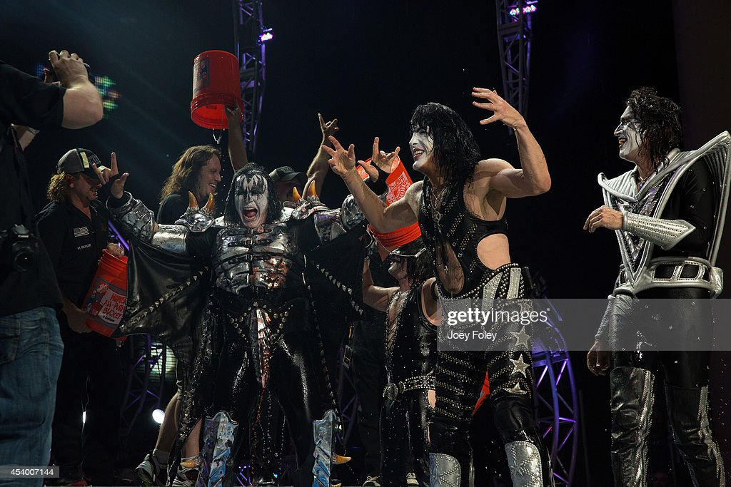 Gene SimmonsPaul Stanley and Tommy Thayer of KISS participates in the ALS Ice Bucket Challenge at Klipsch Music Center on August 22 2014 in...