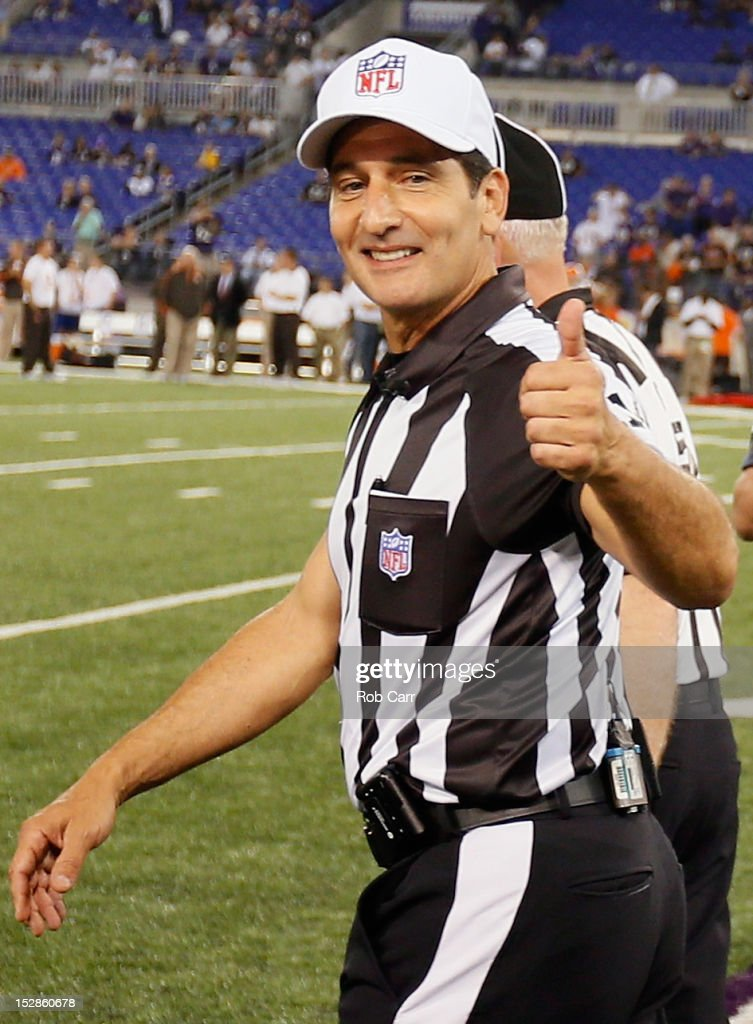 Gene Steratore gives the thumbs after the game officials took the field for the first time this season before the start of the Baltimore Ravens and Cleveland Browns game at M&T Bank Stadium on September 27, 2012 in Baltimore, Maryland.