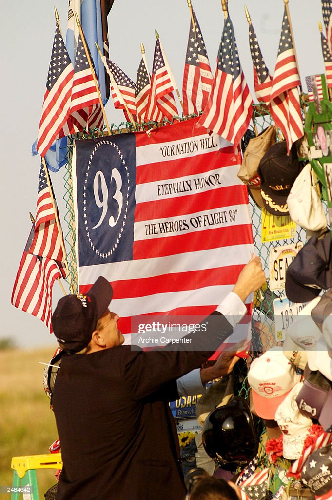 Gene Stilp, designer of the Flight 93 Flag, adjusts his flags that are part of the temporary memorial overlooking the crash site honoring the victims of Flight 93 who lost their lives two years ago today September 11, 2003 in Shanksville, Pennsylvania. The plane crashed September 11, 2001 into a rural field from the presumed target of the nation's capital, killing 40 men and women.
