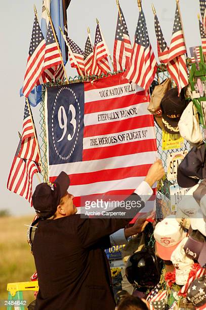 Gene Stilp designer of the Flight 93 Flag adjusts his flags that are part of the temporary memorial overlooking the crash site honoring the victims...