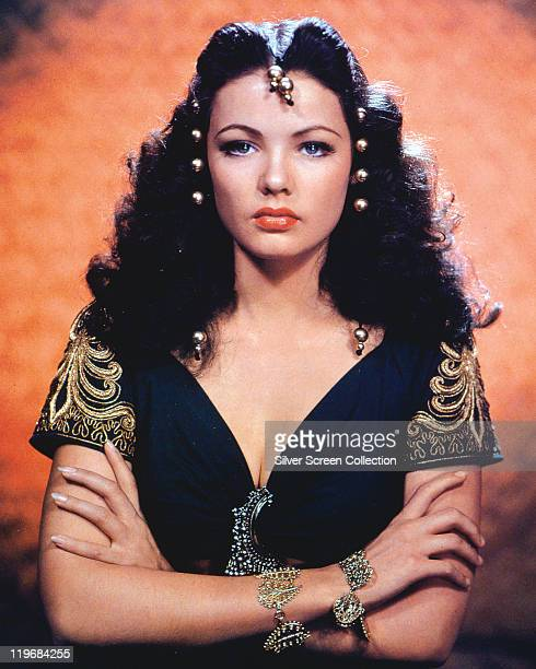 Gene Tierney US actress wearing gold beads in her long curly hair in a publicity portrait issued for tthe film 'Sundown' USA 1941 The war drama...