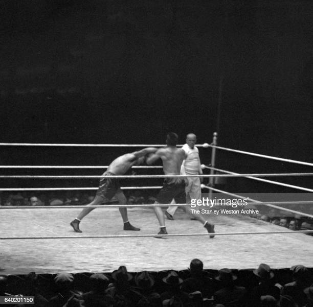 Gene Tunney and Jack Dempsey exchange blows as referee Tommy Reilly watches at Sesquicentennial Stadium Philadelphia Pennsylvania September 23 1926...