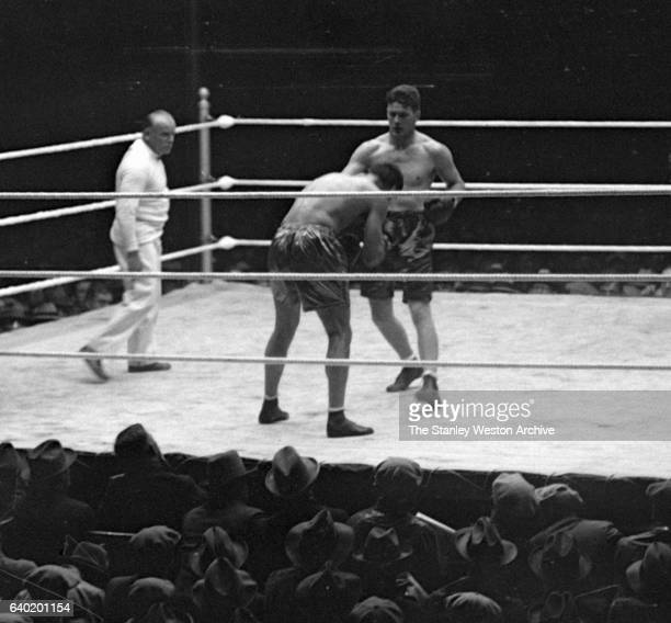 Gene Tunney squares up with Jack Dempsey as referee Tommy Reilly watches at Sesquicentennial Stadium Philadelphia Pennsylvania September 23 1926 Gene...
