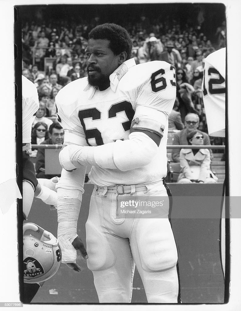 Gene Upshaw of the Oakland Raiders stands on the sidelines during the game against the San Francisco 49ers at Candlestick Park on October 27 1974 in...