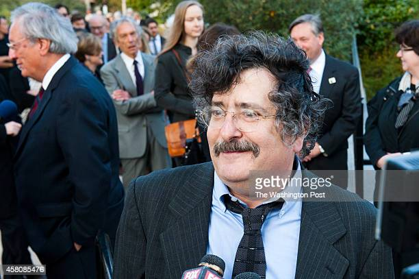 Gene Weingarten columnist and humorist at The Washington Post via Getty Images talks with reporters on his way into the funeral of former executive...