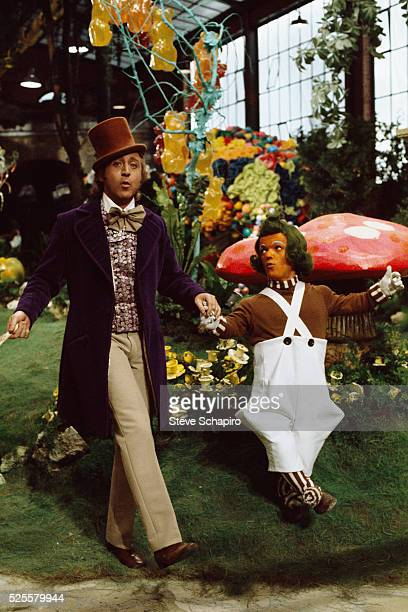 Gene Wilder dances with an unidentified Oompa Loompa on the set of the movie 'Willy Wonka the Chocolate Factory'