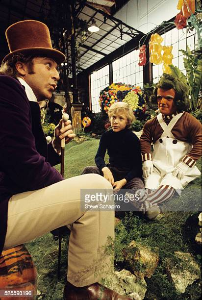 Gene Wilder Peter Ostrum and unknown actor dressed as an Oompa Loompa in the film 'Willy Wonka the Chocolate Factory' 1971