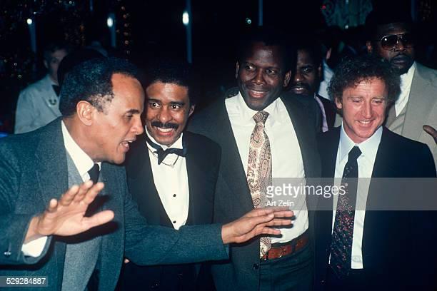 Gene Wilder Sidney Poitier Richard Pryor listening to Harry Belafonte circa 1970 New York