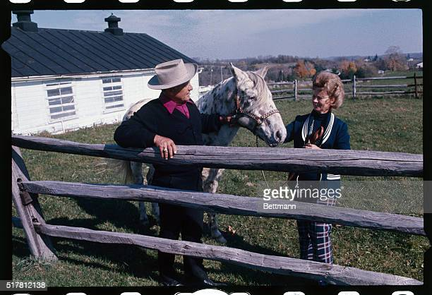 Gene Woodling former NY Yankee outfielder and his wife Betty admire one of the Appaloosa horses they breed on a farm just outside of Medina This is...