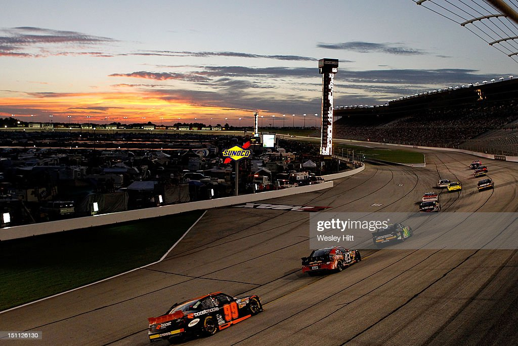 A gener view of cars racing as the sun sets during the NASCAR Nationwide Series NRA American Warrior 300 at Atlanta Motor Speedway on September 1, 2012 in Hampton, Georgia.