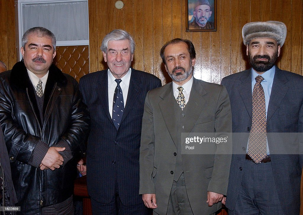 General Abdul Rashid Dostum (L) the United Nations High Commisioner for Refugees Ruud Lubbers, (2nd from L), Afghanistan's Minister of Refugees and Repatriation Inayatullah Nazeri (2nd from R), and Atta Mohammed (R), pose for a photo following their meeting at the Ministry of Foreign Affairs February 28, 2003 in Mazar-e-Sharif, Afghanistan. The group, which included numerous factional leaders from northern Afghanistan, unanimously agreed to improve the infrastructure of the region so displaced people can return home.