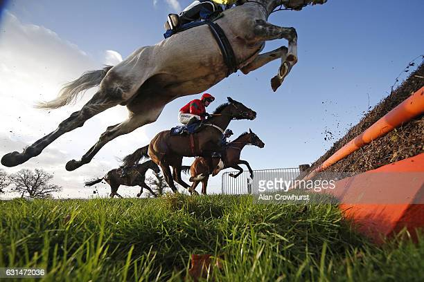 General action as runners clear a fence at Taunton Racecourse on January 11 2017 in Taunton England