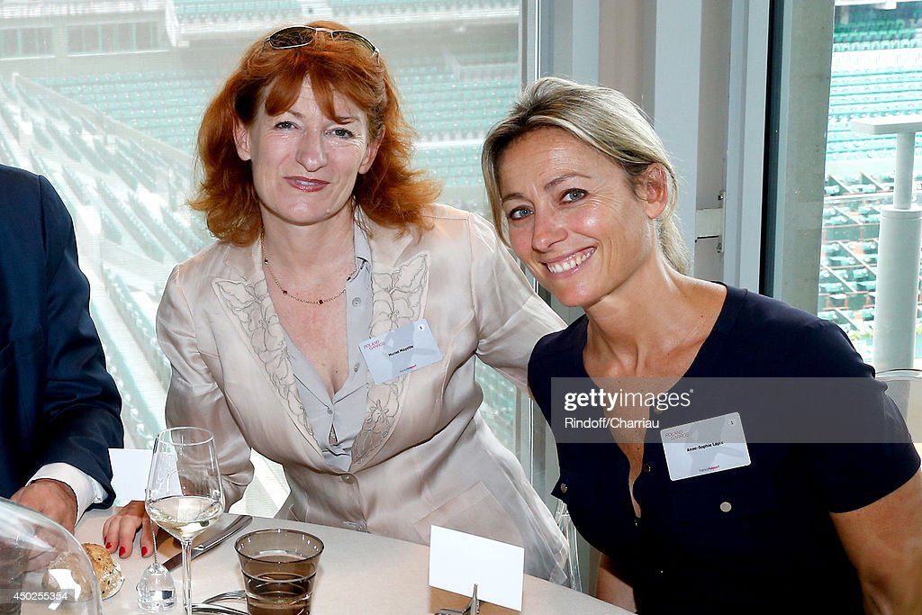 General administrator of Comedie Francaise Muriel Mayette and Anne-Sophie Lapix pose at France Television french chanels studio after she won the Roland Garros French Tennis Open 2014 - Day 14 on June 7, 2014 in Paris, France.