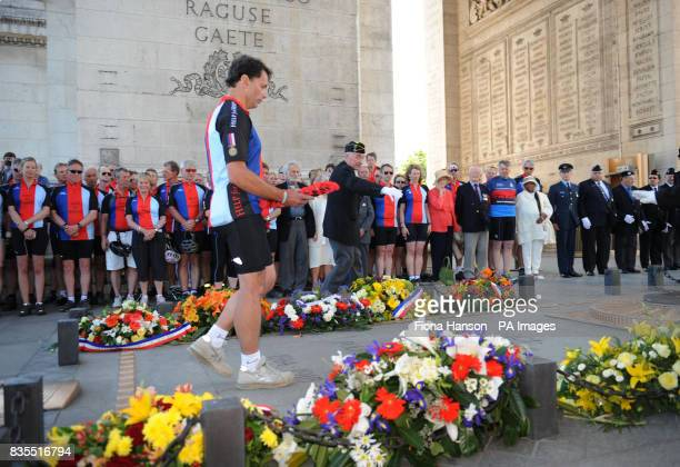 General Andrew Gregory watched by cyclists from the Help for Heroes Band of Brothers bike riders attend a wreath laying ceremony at the Arc de...