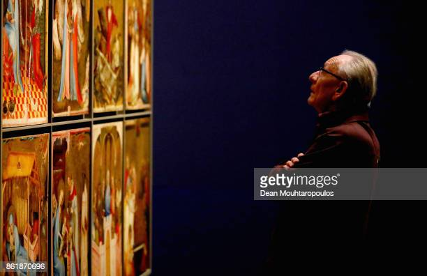 A general as visitors view the Two Wings of a Marian Altarpiece know as the Middle Rhine Altarpiece by Johan Maelwael during a special exhibition...