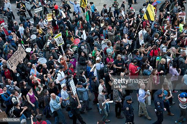 General atmosphere of May Day demonstrators during the Occupy Wall Street May 1st General Strike March down Broadway in New York City