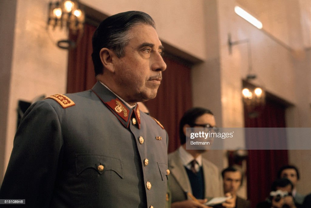 General <a gi-track='captionPersonalityLinkClicked' href=/galleries/search?phrase=Augusto+Pinochet&family=editorial&specificpeople=93107 ng-click='$event.stopPropagation()'>Augusto Pinochet</a>, head of Chile's ruling military junta, holds a news conference at Santiago's War College on September 21, 1973. Pinochet states that neither the US nor any other foreign nation was involved in the coup d'etat that overthrew the Marxist government of President Salvador Allende.