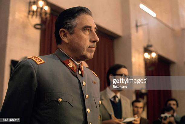 General Augusto Pinochet head of Chile's ruling military junta holds a news conference at Santiago's War College on September 21 1973 Pinochet states...