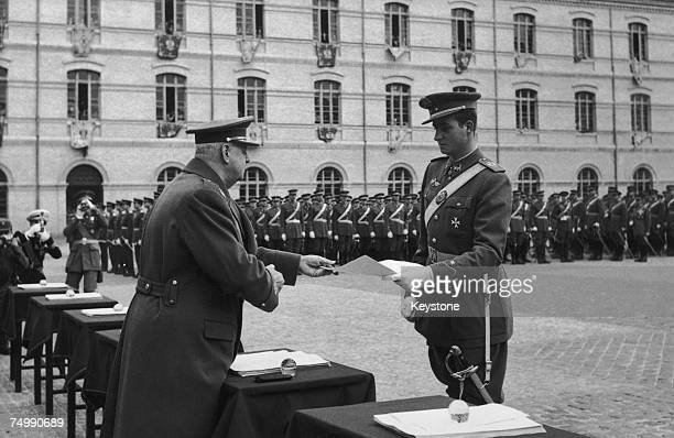 General Barroso the Spanish Minister of Defence presents Prince Juan Carlos of Spain with his diploma at the Military Academy in Zaragoza 15th...