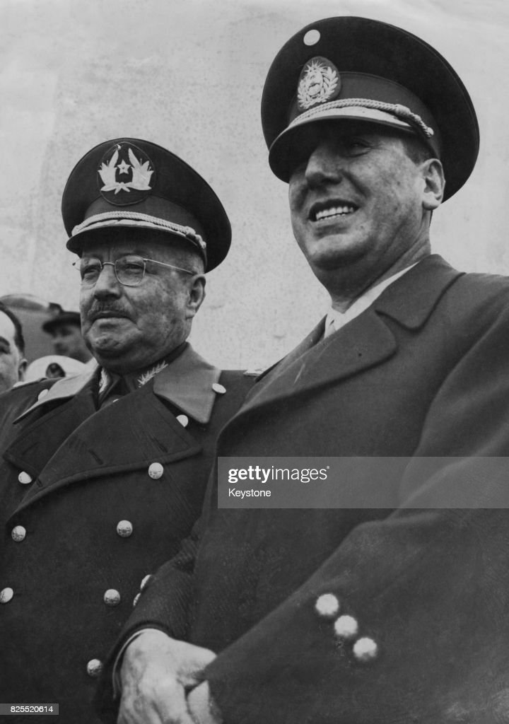 General Carlos Ibanez del Campo (1877 - 1960, left), the President of Chile, is met at the airport by Juan Peron (1895 - 1974), President of Argentina, upon his arrival at Buenos Aires for an official visit, 6th July 1953.