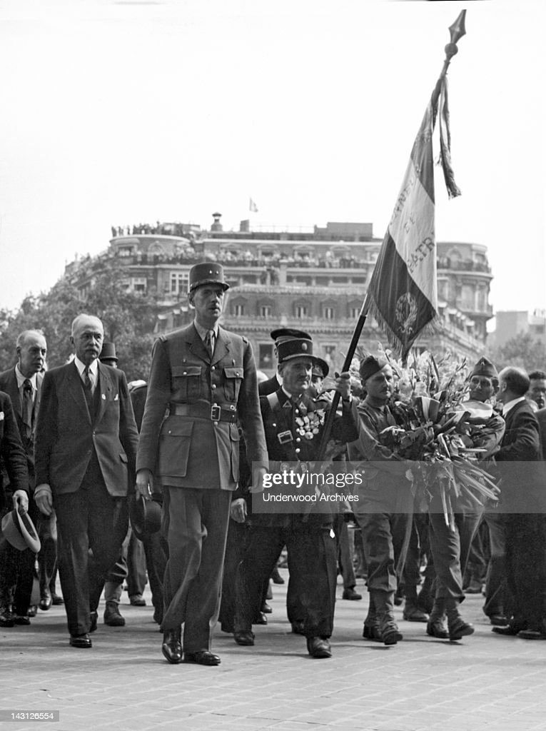 General Charles de Gaulle walks up to place a wreath on the Tomb of the Unknown Solder beneath the Arc de Triomphe, Paris, France, August 27, 1944.