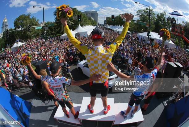 General classification winner Tejay van Garderen of the United States riding for the BMC Racing Team celebrates on the podium with second place...