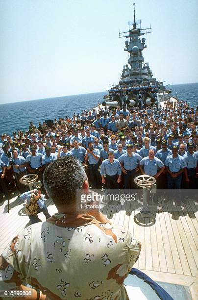 General Colin L Powell chairman of the Joint Chiefs of Staff addresses the crew of the battleship USS Wisconsin while visiting the ship in the...
