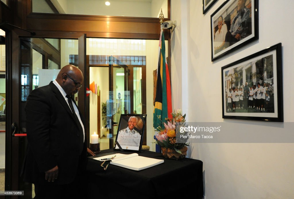 General Consul of South Africa Rachel Tlalane Rauleka in Milan stands before a condolence book in memory of Nelson Mandela at the General Consulate of South Africa on December 6, 2013 in Milan, Italy. Mandela was a leader that helped conquer apartheid in racially divided South Africa after being jailed for his activism for decades. He was South Africa's first black president. He died yesterday at the age of 95.