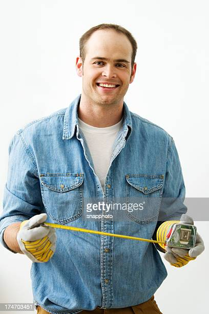 General Contractor Holding Tape Measure
