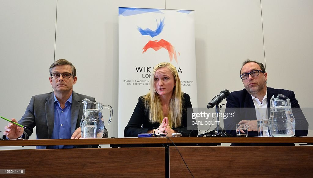 General Counsel or the Wikimedia Foundation, Geoff Brigham; Wikimedia Foundation Chief Executive, Lila Tretikov and Wikipedia co-founder, Jimmy Wales, attend a press conference in central London on August 6, 2014 ahead of the Wikimania conference.