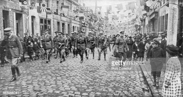 General Currie and Canadian troops walking through a liberated town 27 October 1918 Currie commanded the Canadian Corps of the British Expeditionary...