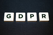 Close up of board game tiles/pieces spelling GDPR