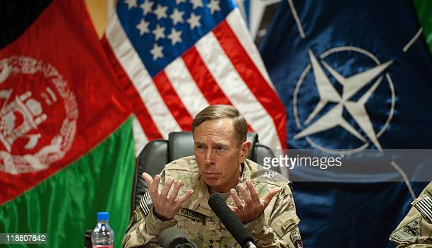US General David Petraeus conducts a question and answer session with the media traveling with US Secretary of Defense Leon Panetta July 9 inside...