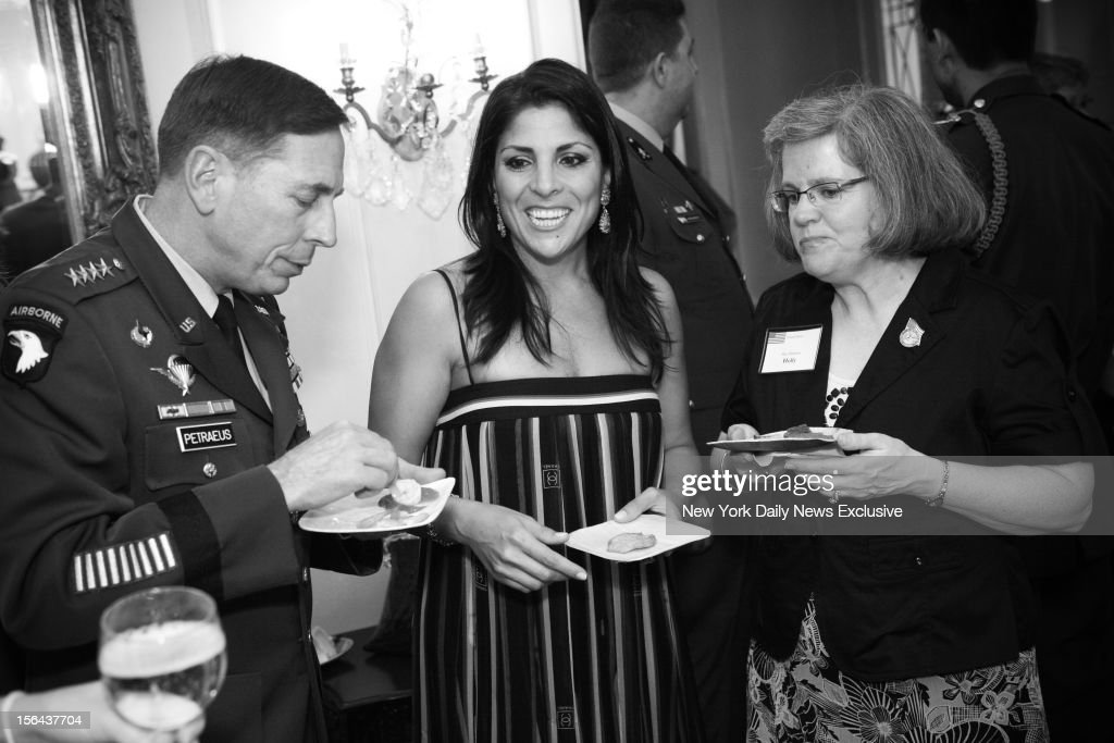 General David Petraeus, Jill Kelley and Holly Petraeus (l.- r.) attending event in which Gen. Petraeus was presented with community service award at the home of Jill and Scott Kelley during summer of 2011.