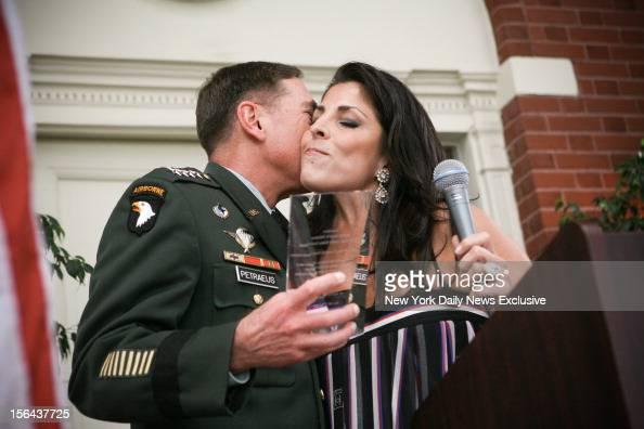General David Petraeus kisses Jill Kelley after accepting community service award presented at Kelley's home during the summer of 2011