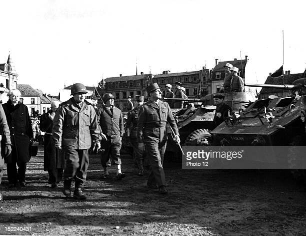 General De Lattre de Tassigny C G 1st French Army US Maj Gen Frank W Milburn C G XXI Corps and US Maj Gen C G 28th Inf Div makes inspection tour of...