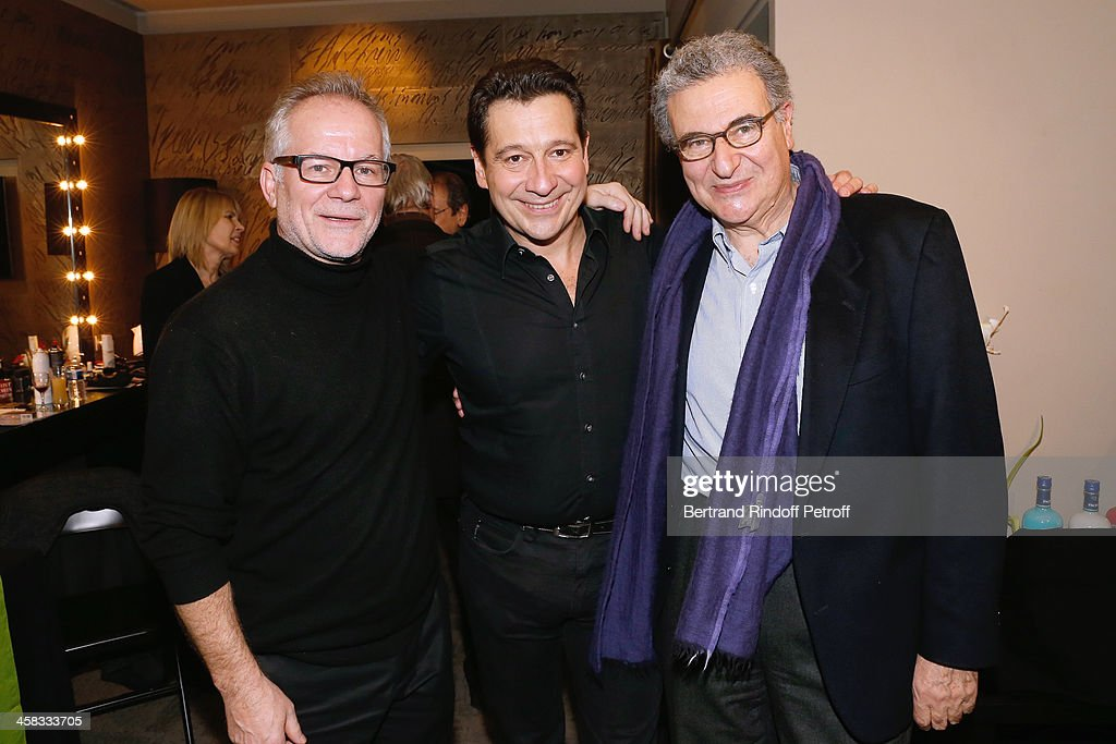 General Delegate of the Cannes Film Festival Thierry Fremaux, Laurent Gerra and Secretary General of the French cinematheque Serge Toubiana pose backstage following the show of impersonator Laurent Gerra 'Un spectacle Normal' at L'Olympia on December 20, 2013 in Paris, France.