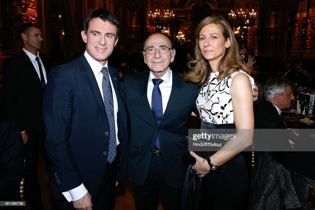 General delegate of Weizmann Institute Robert Parienti standing between French Prime Minister Manuel Valls and his wife violonist Anne gravoin attend Weizmann Institute celebrates its 40 Anniversary at Opera Garnier in Paris on January 12, 2015 in Paris, France.