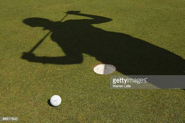 General detail of the shadow of a golfer on the practice putting green during the first round of the 2009 Ricoh Women's British Open Championship...