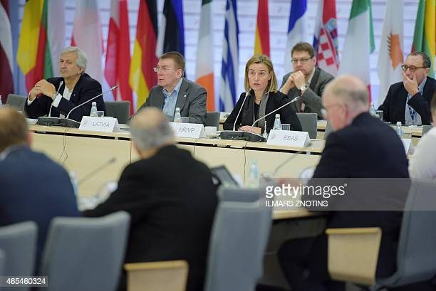 General Director of EU Council Leonardo Schiavo Latvian Foreign Minister Edgar Rinkevics and High Representative of the European Union for Foreign...