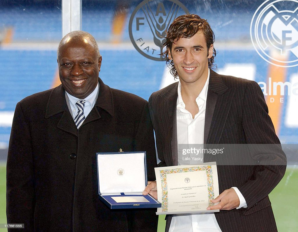 General Director of FAO <a gi-track='captionPersonalityLinkClicked' href=/galleries/search?phrase=Jacques+Diouf&family=editorial&specificpeople=632850 ng-click='$event.stopPropagation()'>Jacques Diouf</a> and Raul during Real Madrid's Raul Invested as International Ambassador of FAO (Food and Agriculture Organization for the United Nations) at Santiago Bernabeu Stadium in Madrid, Spain.