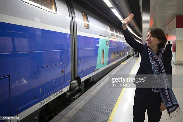 General director of French railway company SNCF Voyages Barbara Dalibard waves as the first high speed TGV train connecting France to Spain leaves...