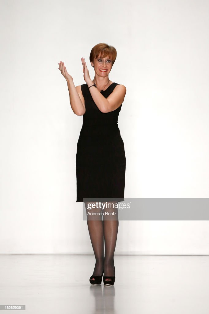 General Director of Sudar Svetlana Stepanova salutes the crowd after the 'Sudar' PLC, TM 'VENZANO'. Styled By 'Leonid Alexeev' show during the Mercedes-Benz Fashion Week Russia S/S 2014 on October 25, 2013 in Moscow, Russia.