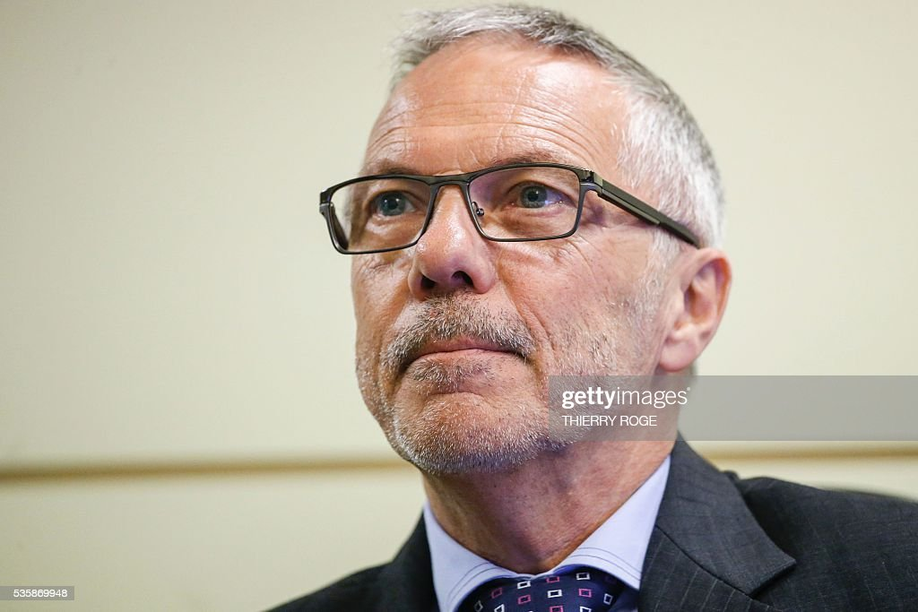 General director of the Belgian Union of Professional Insurance Companies Assuralia Rene Dhondt looks on as he answers questions during a hearing of the parliamentary inquiry commission for Brussels' terror attacks of March 22, at the Belgian Federal Parliament, in Brussels on May 30, 2016. / AFP / Belga / THIERRY ROGE / Belgium OUT