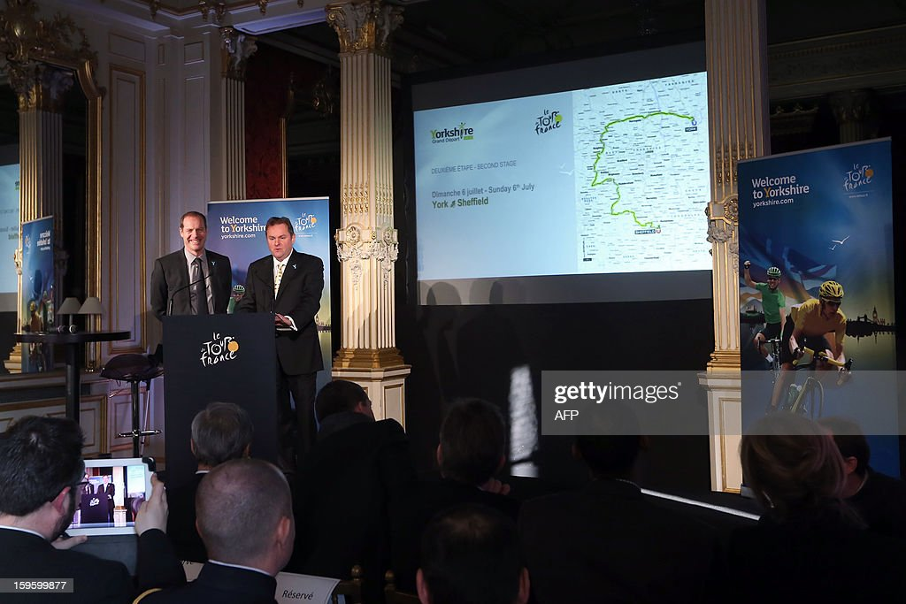 General director of the Tour de France Christian Prudhomme (L) and CEO of 'Welcome to Yorkshire' Gary Verity stand next to a map showing the route of the second stage of the 101st edition of the Tour de France on January 17, 2013 in Paris, during the official presentation of the 2014 Tour de France's 'Grand depart' (Great departure). The 2014 Tour de France will start with a stage between Leeds and Harrogate in the northern English county of Yorkshire on July 5, organisers of cycling's most prestigious and gruelling race announced today. AFP PHOTO / THOMAS SAMSON