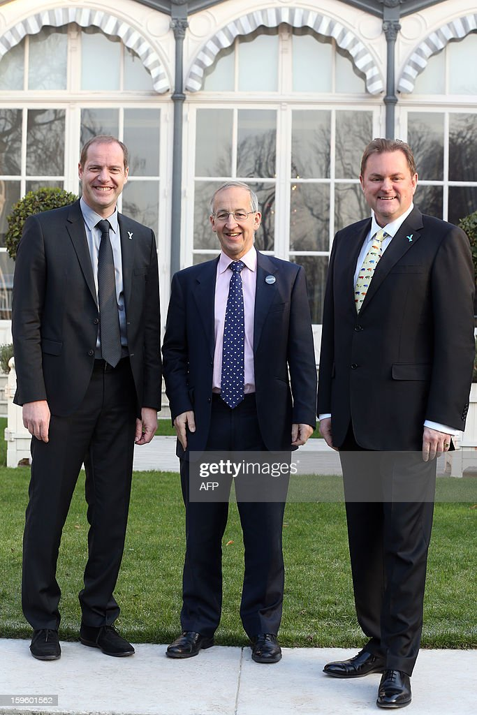 General director of the Tour de France Christian Prudhomme (L) Britain's ambassador to France Peter Ricketts (C) and CEO of 'Welcome to Yorkshire' Gary Verity pose on January 17, 2013 in Paris, prior to the official presentation of the 2014 Tour de France's 'Grand depart' (Great departure). The 2014 Tour de France will start with a stage between Leeds and Harrogate in the northern English county of Yorkshire on July 5, organisers of cycling's most prestigious and gruelling race announced today. AFP PHOTO / THOMAS SAMSON