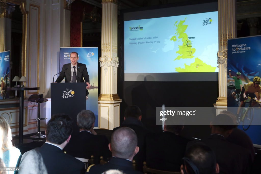 General director of the Tour de France Christian Prudhomme delivers a speech next to a map of Great Britain, on January 17, 2013 in Paris, during the official presentation of the 2014 Tour de France's 'Grand depart' (Great departure). The 2014 Tour de France will start with a stage between Leeds and Harrogate in the northern English county of Yorkshire on July 5, organisers of cycling's most prestigious and gruelling race announced today.