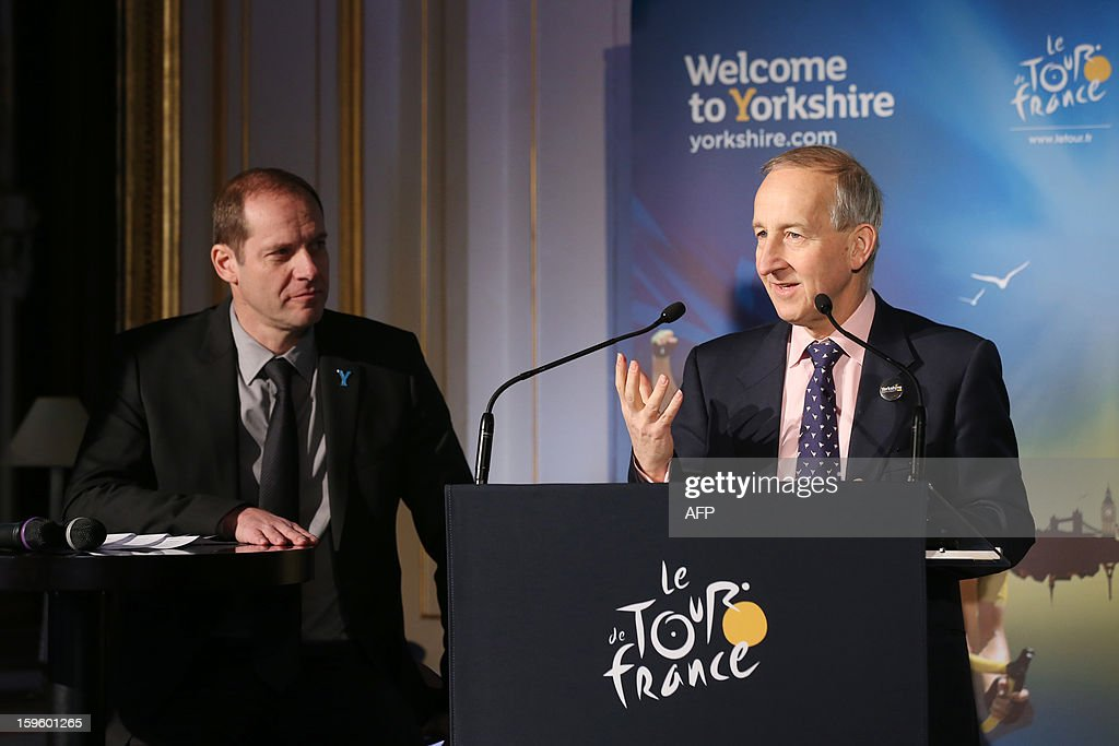 General director of the Tour de France Christian Prudhomme (L) listens tod Britain's ambassador to France, Peter Ricketts on January 17, 2013 in Paris, during the official presentation of the 2014 Tour de France's 'Grand depart' (Great departure). The 2014 Tour de France will start with a stage between Leeds and Harrogate in the northern English county of Yorkshire on July 5, organisers of cycling's most prestigious and gruelling race announced today.